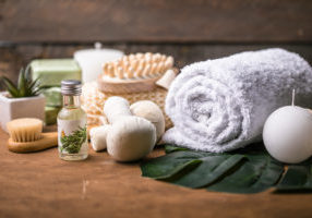 Wellness decoration, spa massage setting,  oil on wooden background. Spa, Zen and relax concept.SPA concept: composition of spa treatment with spa stone. Massage.
